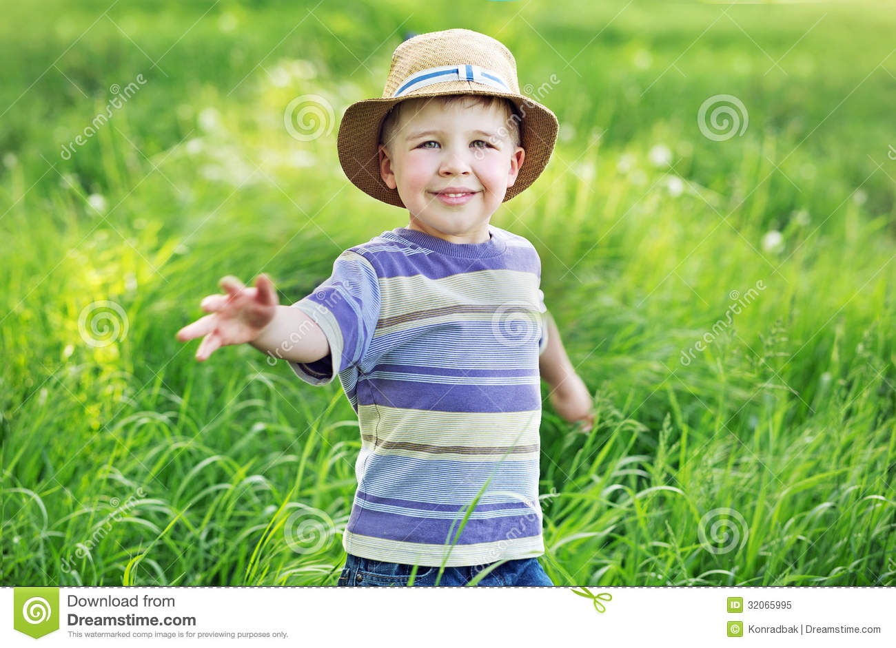Portrait Of A Cute Small Boy Playing On The Meadow Royalty
