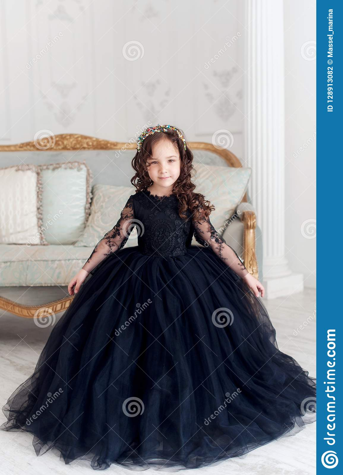 8381a2116caf Portrait Of Cute Smiling Little Girl In Black Princess Fluffy Dress ...