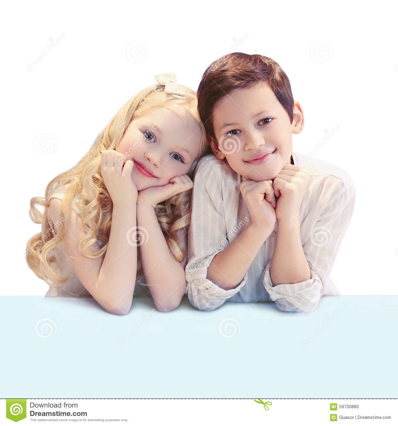 Portrait of cute smiling two children sitting at the table