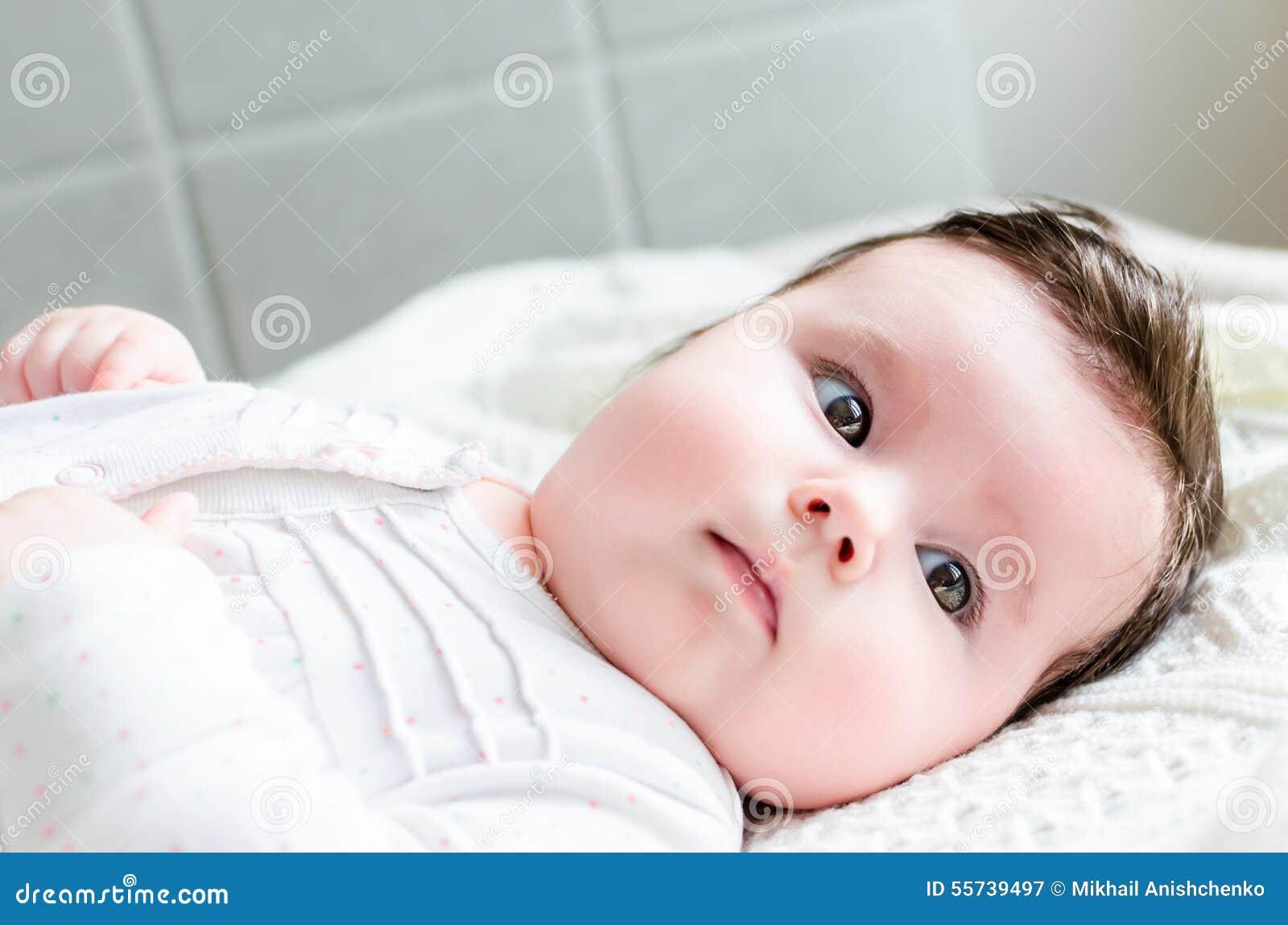 Portrait of cute sweet little newborn baby girl