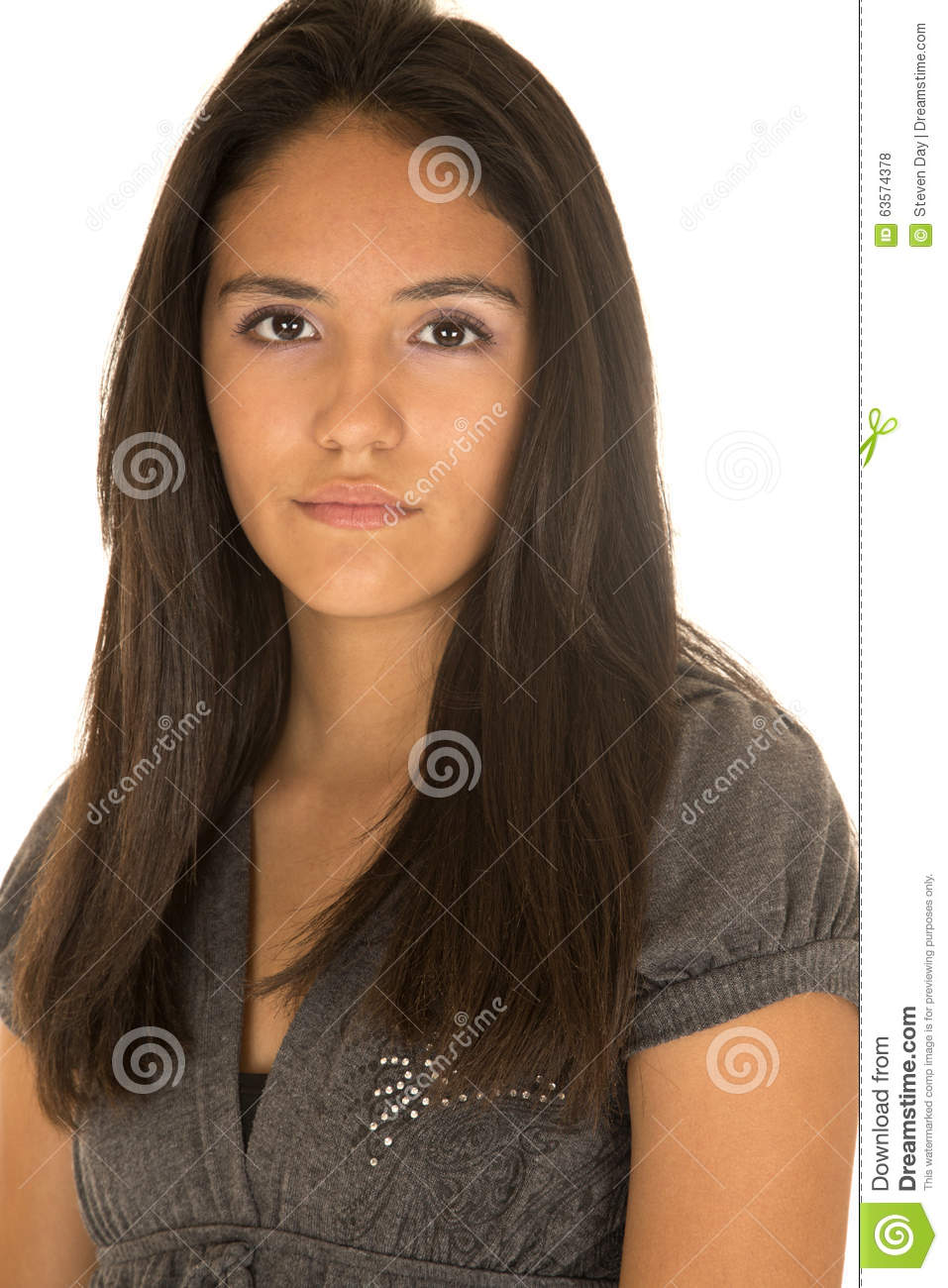 Portrait of cute teen Hispanic girl serious expression