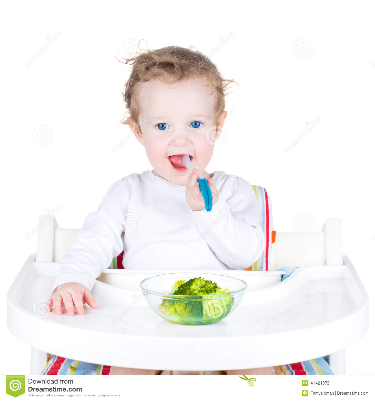 Portrait of a cute toddler eating broccoli in a white high for Cute toddler chairs