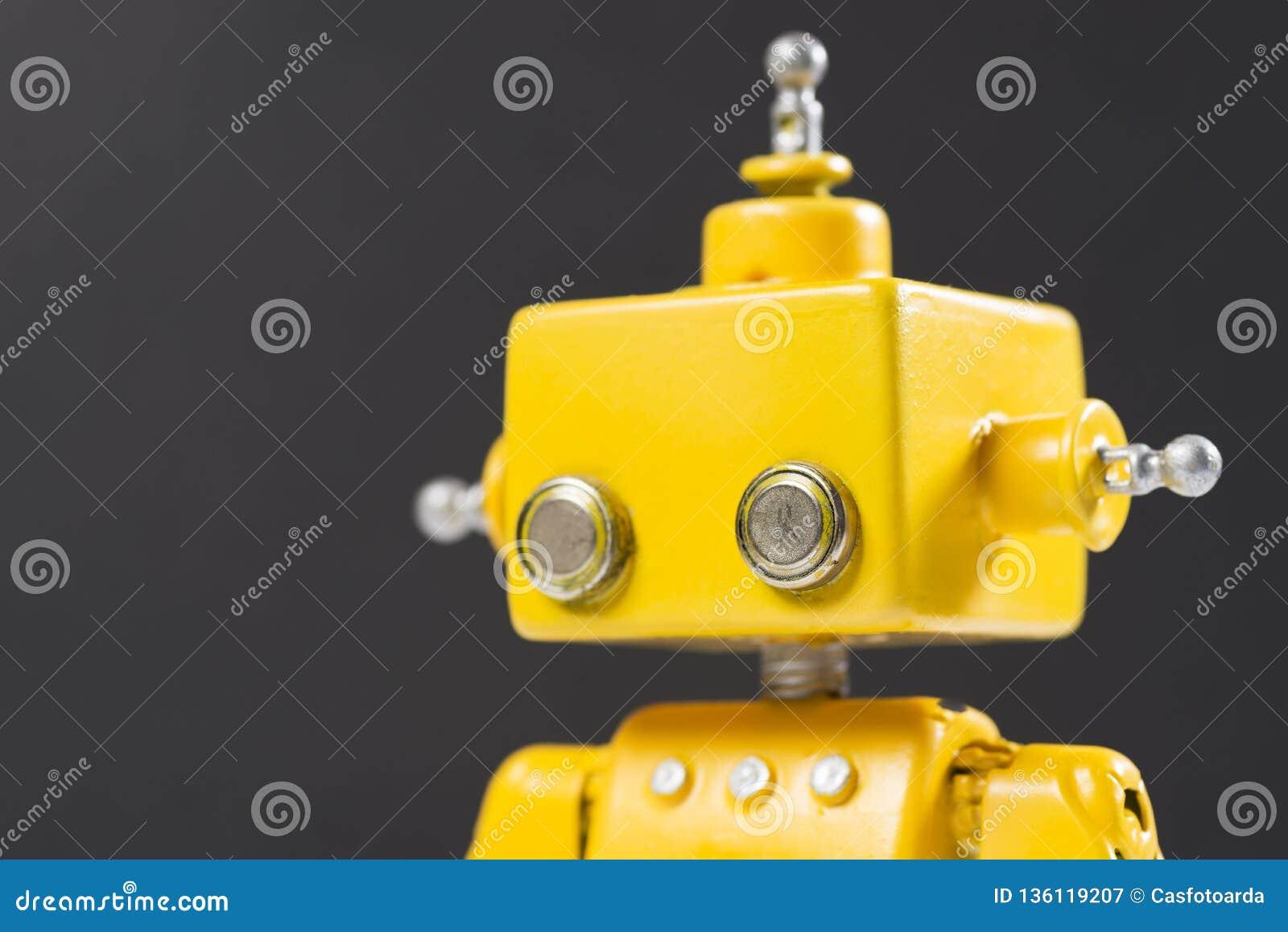 Portrait of a Cute, yellow, handmade robot