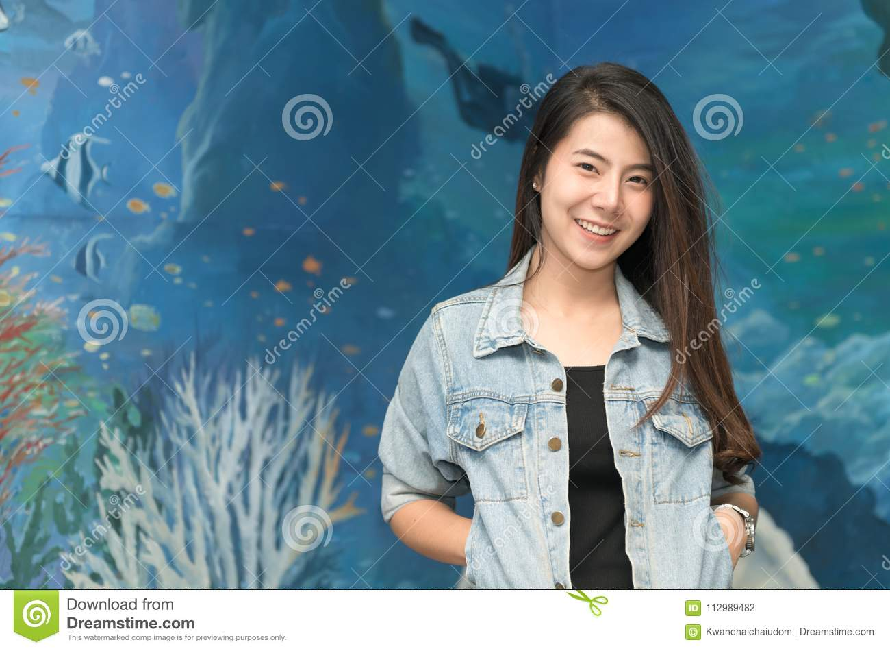 Portrait of cute young student in jacket jeans smile