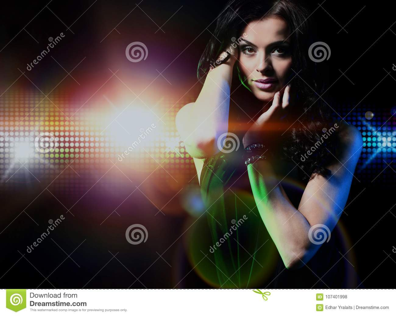 Portrait of dancing girl on disco party.