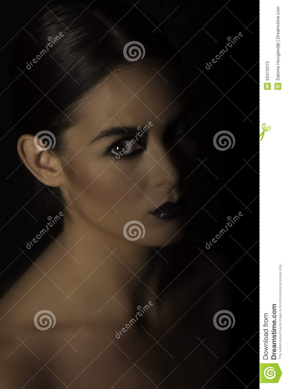 Portrait Of Dark Haired Woman With Dramatic Black Makeup