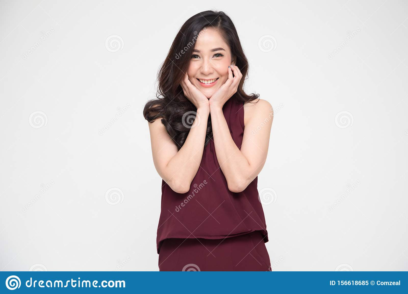 Portrait of delighted Asian woman smiling and dreamy expression,