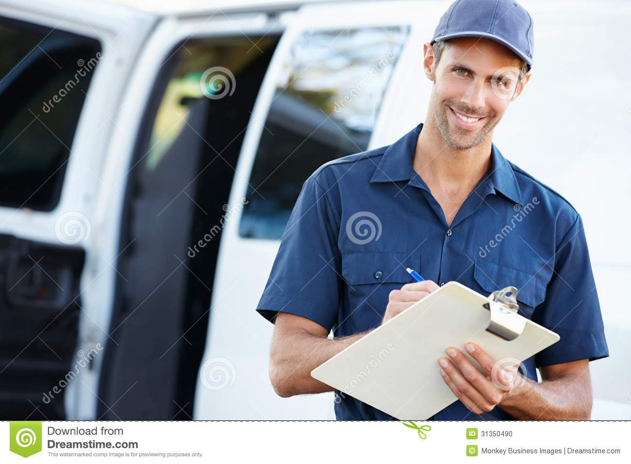 Delivery Driver Sitting In Van Using Digital Tablet Stock Photo ...