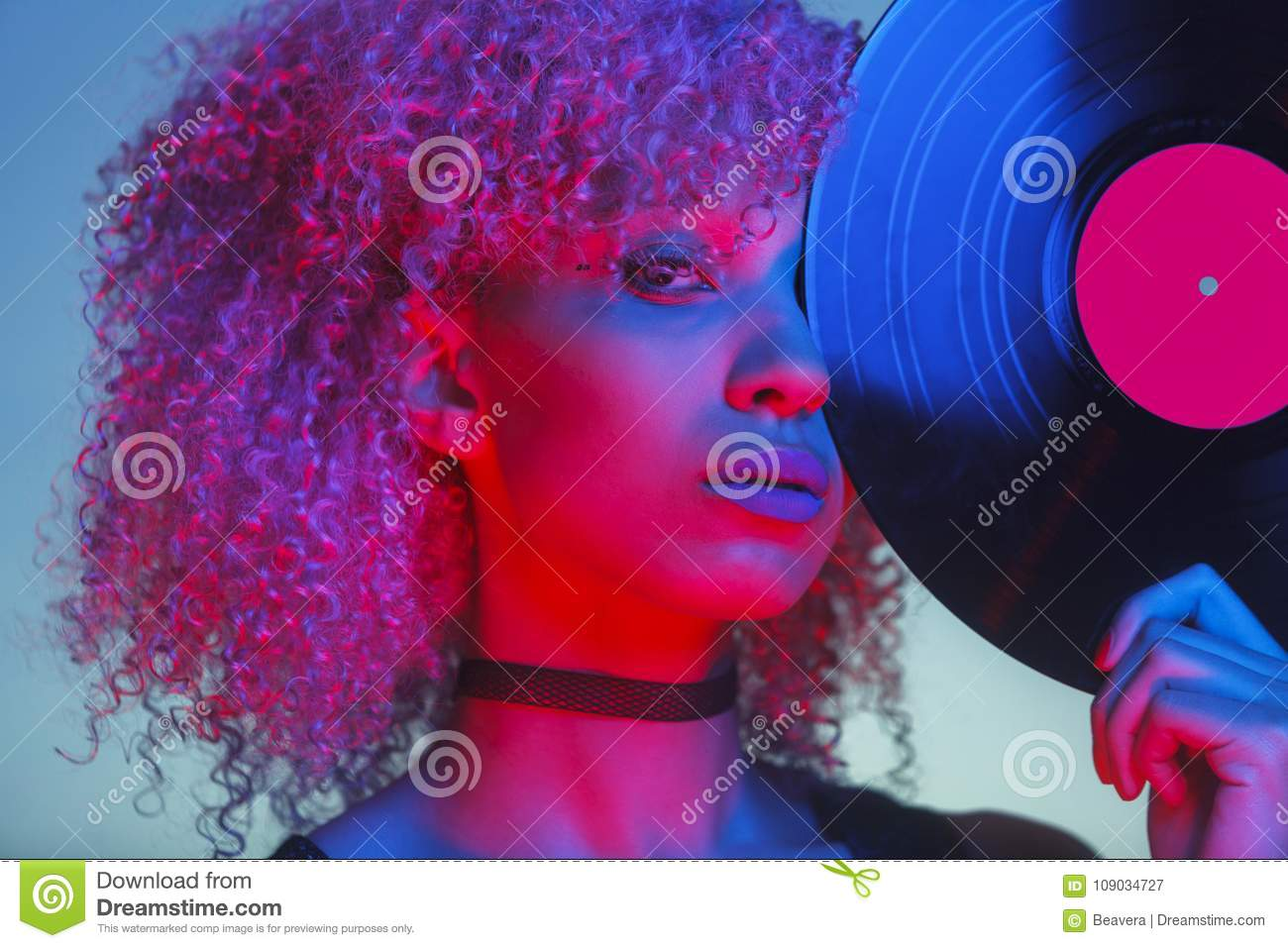 Portrait of a disco woman holding a vinyl with eighties music an
