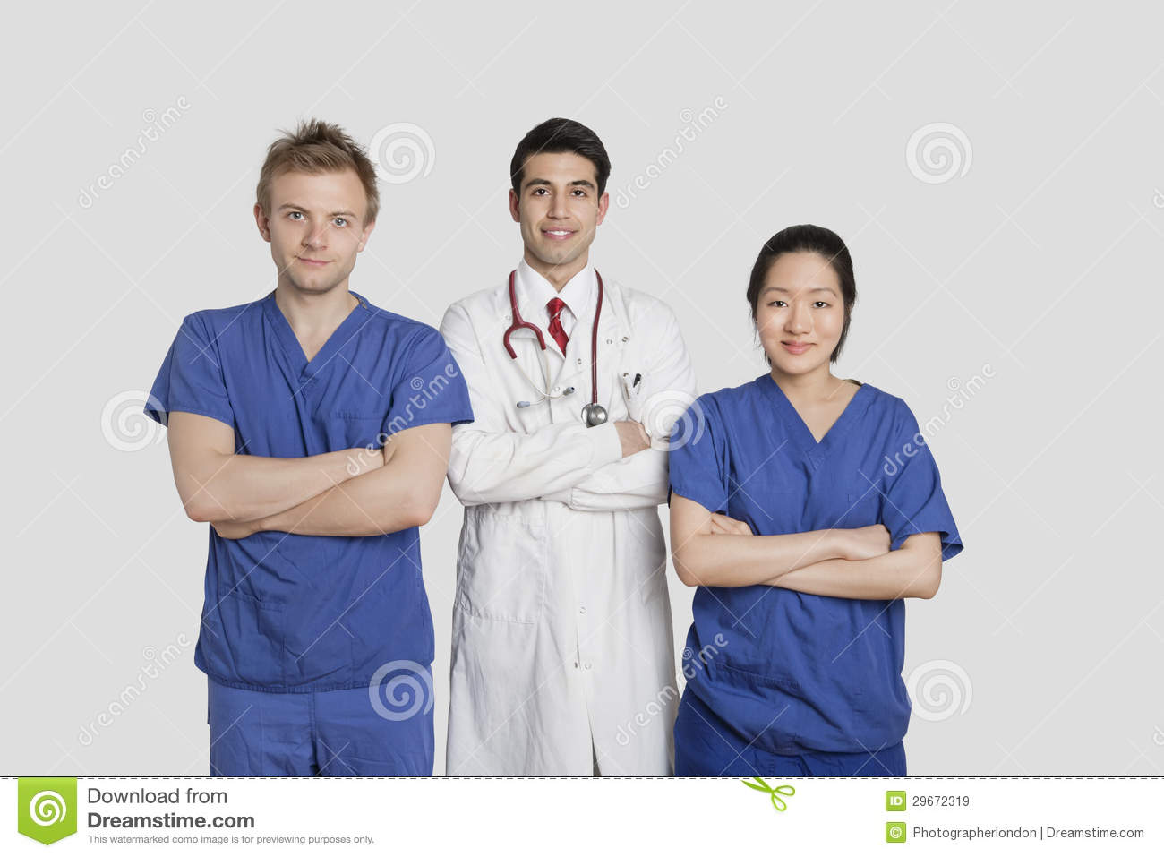 Portrait Of Diverse Healthcare Workers Standing With Hands