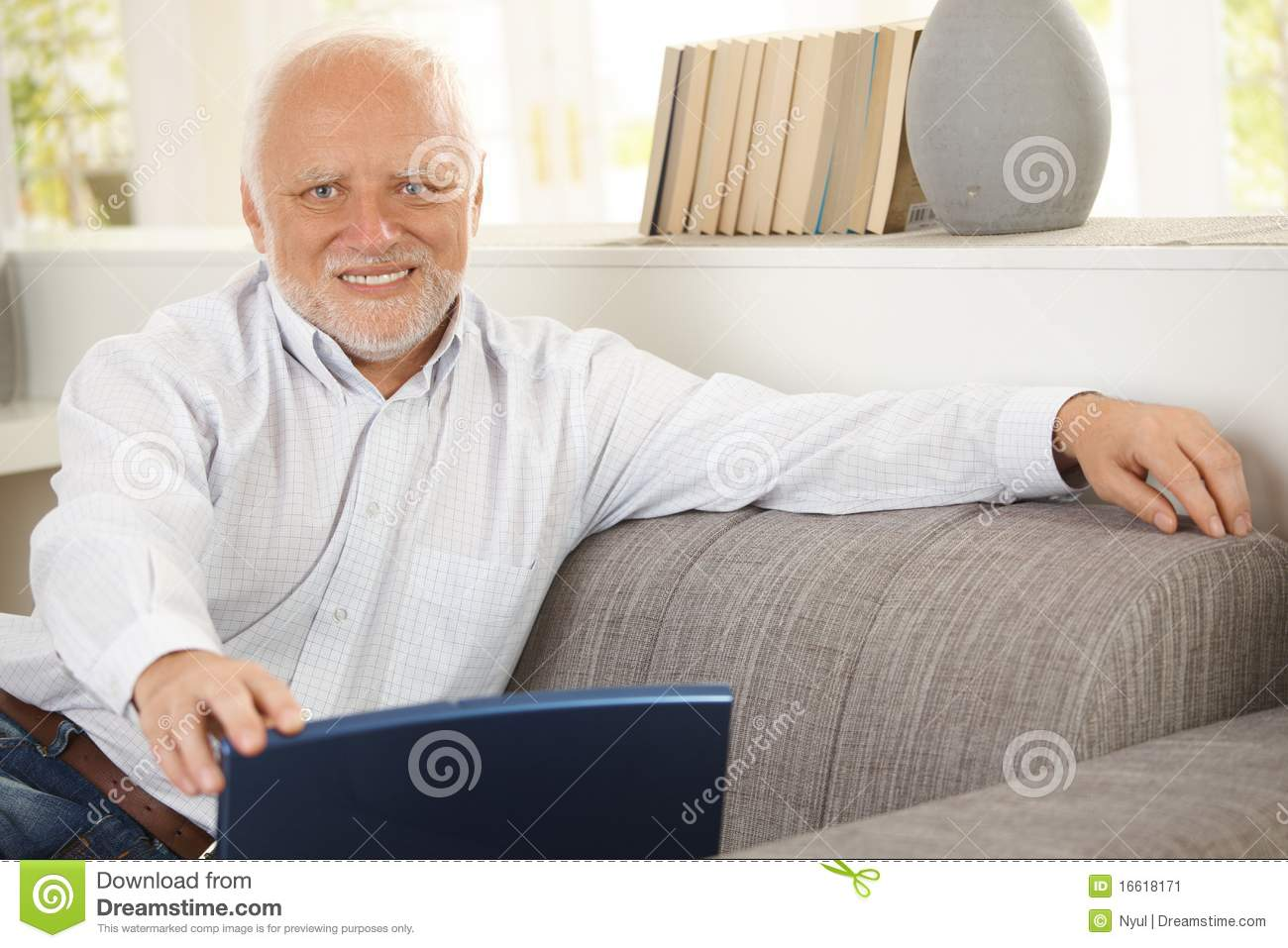 Portrait Of Elderly Man Sitting On Sofa Stock Image