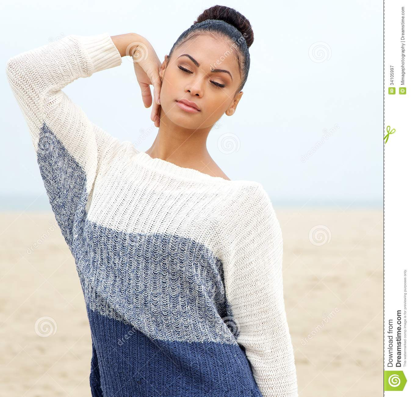 Portrait Of An Elegant Young Woman Posing At The Beach ...