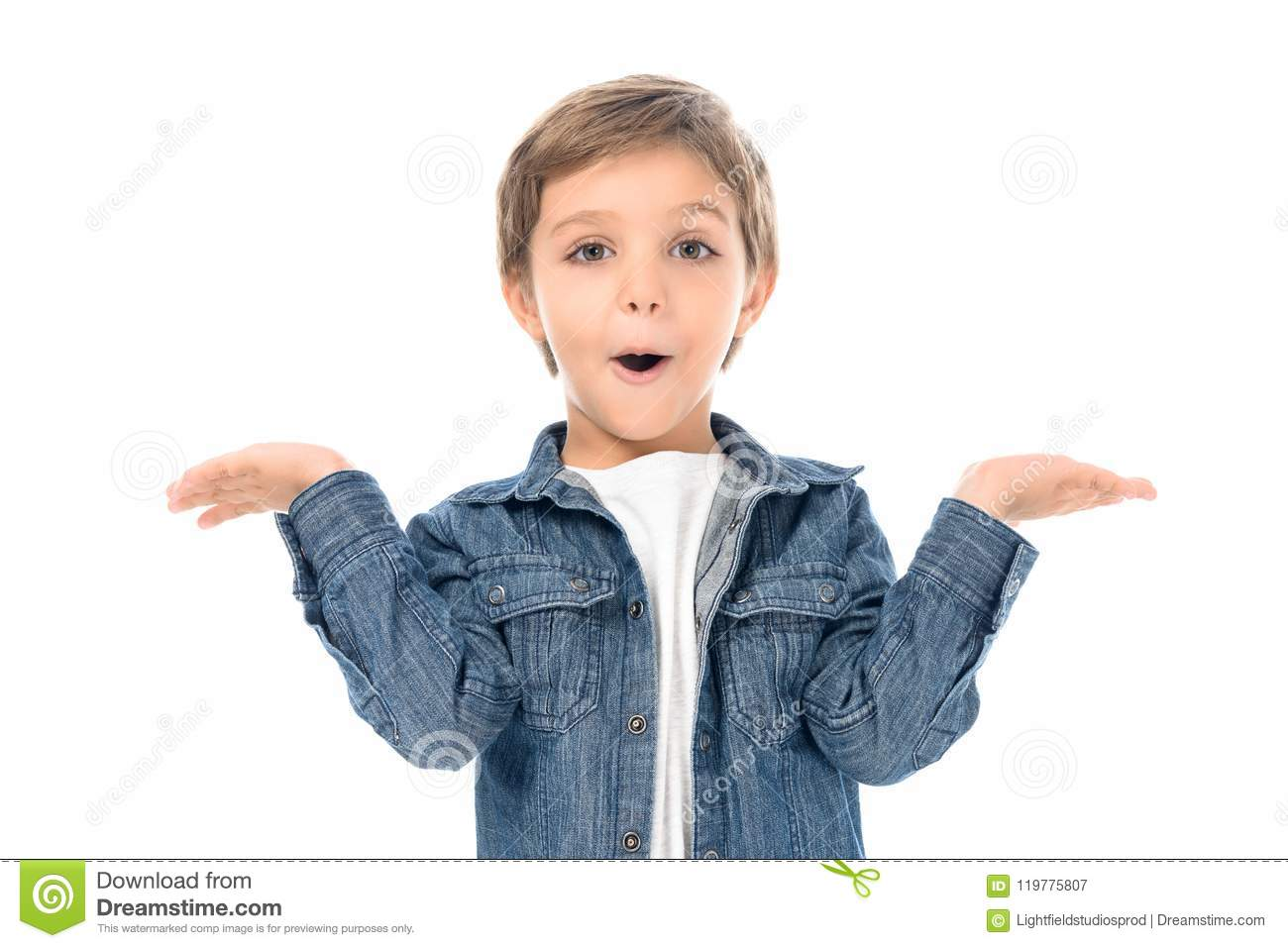 portrait of excited little boy with outstretched arms looking at camera