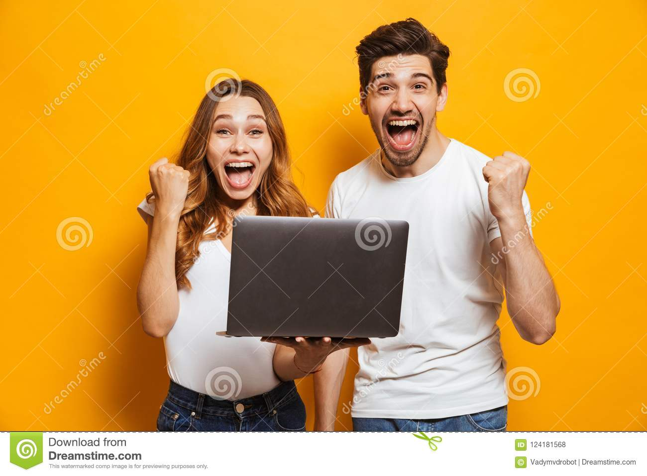 Portrait of excited man and woman screaming and clenching fists