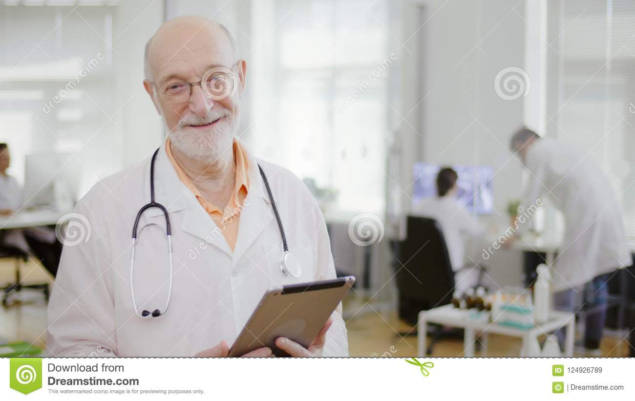 Close up of experienced smiling doctor
