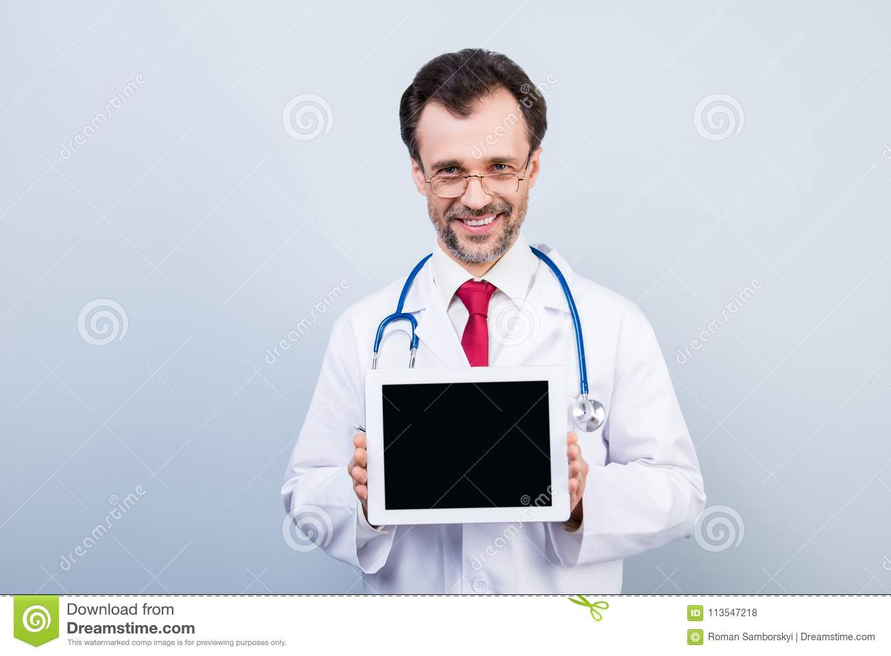 Portrait of experienced qualified cheerful confident doctor demo