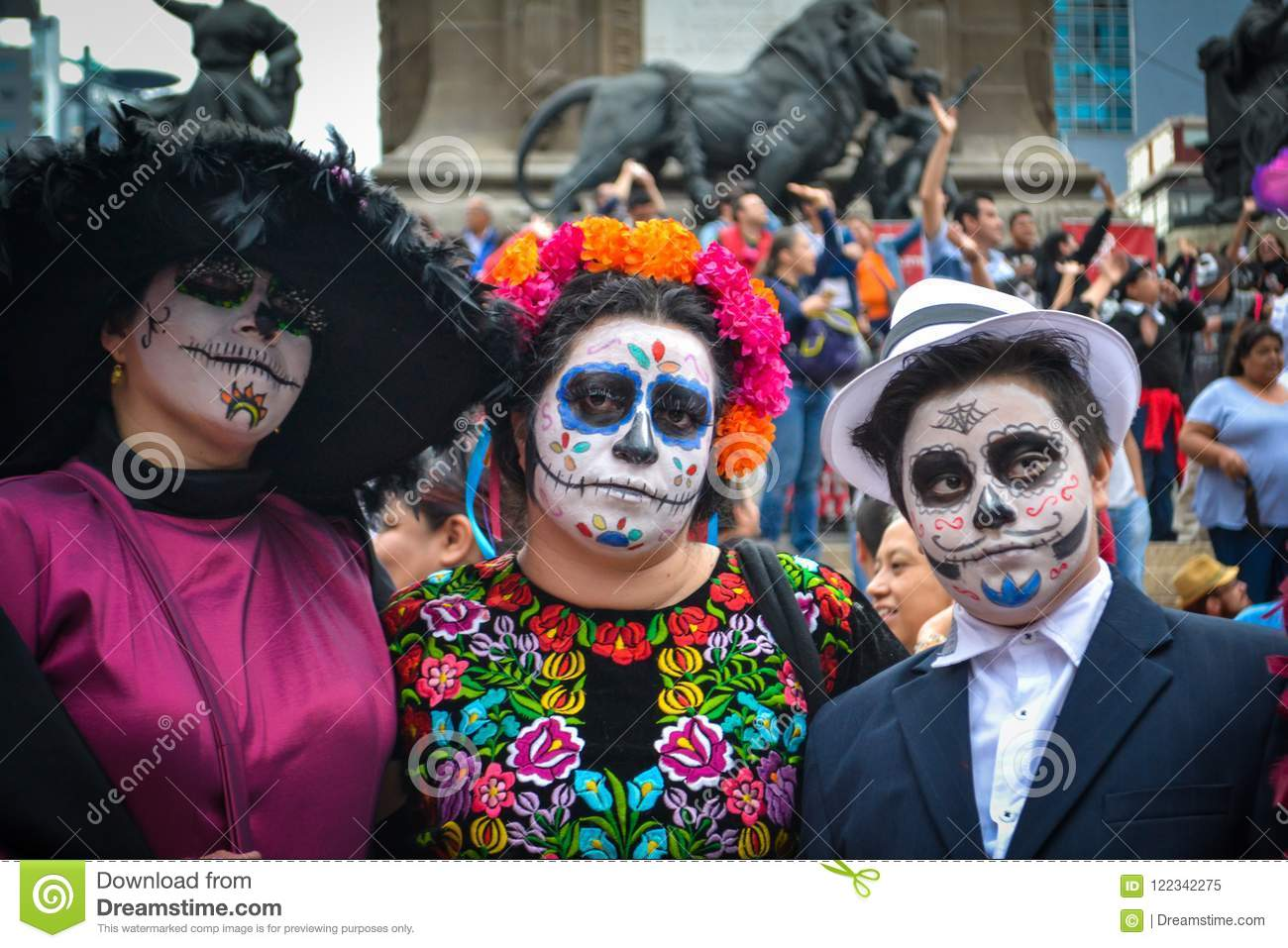 Mexico City, Mexico, ; October 26 2016: Portrait of a family in disguise at the Day of the Dead parade in Mexico City
