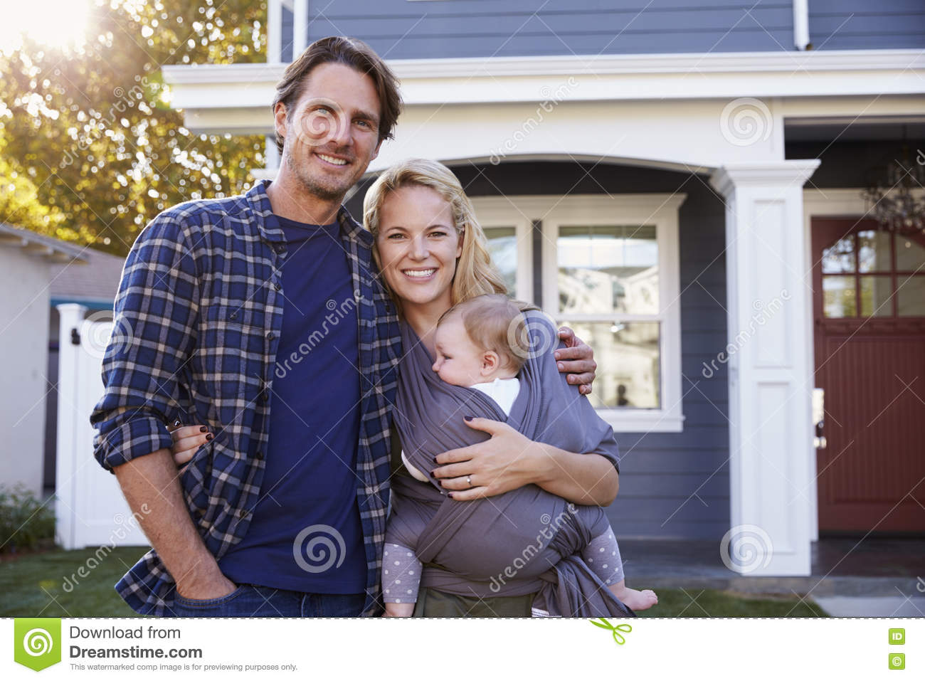 Portrait Of Family Standing Outside House