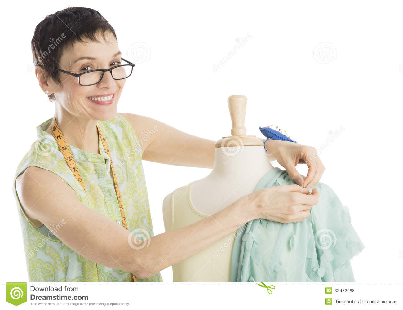 Portrait Of Fashion Designer Pinning Clothes To Mannequin
