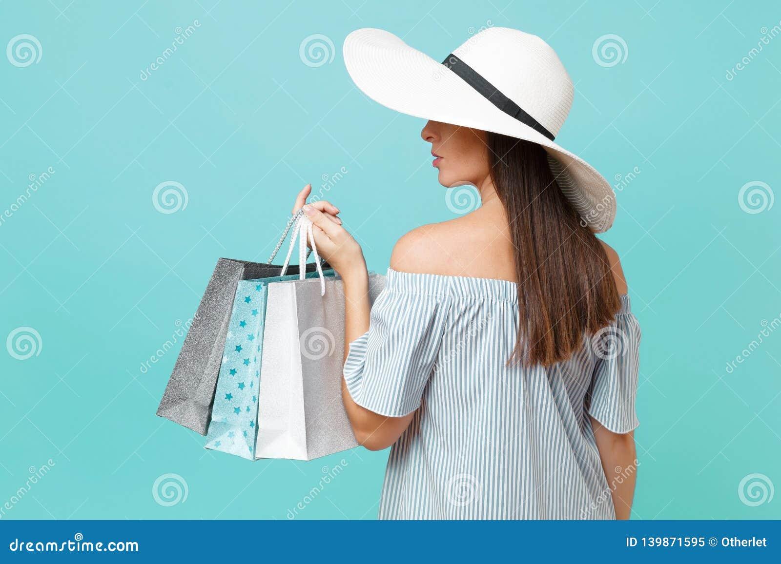 Portrait fashionable elegant fashion beautiful caucasian woman in summer dress, white large wide brim sun hat holding