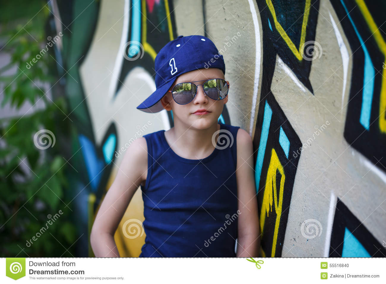 4cfa83a14d78 Portrait of Fashionable little boy in sunglasses and cap.Graffiti  background. Summertime. Outdoors. More similar stock images