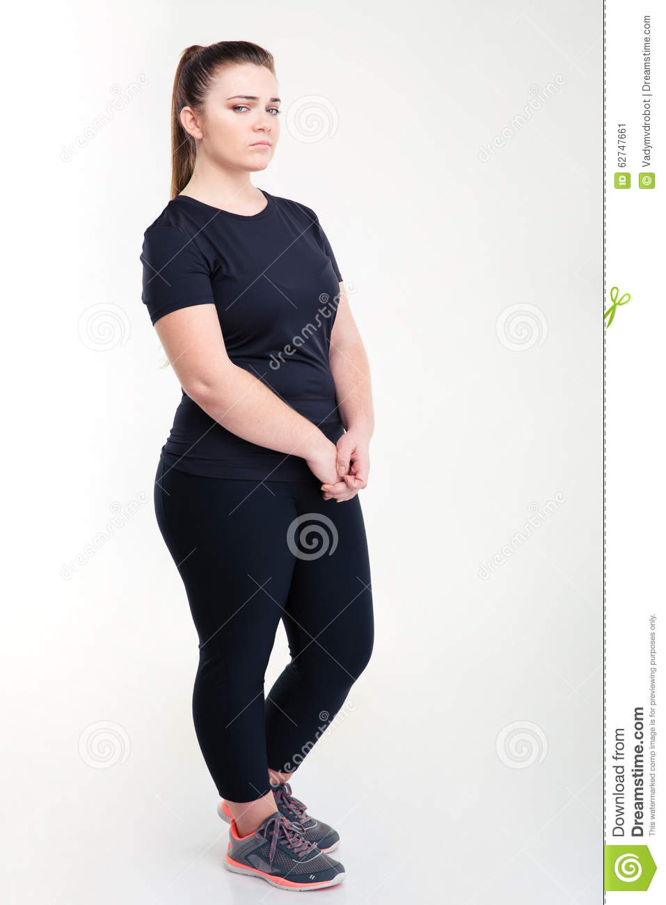 Portrait of a fat sad woman in sportswear
