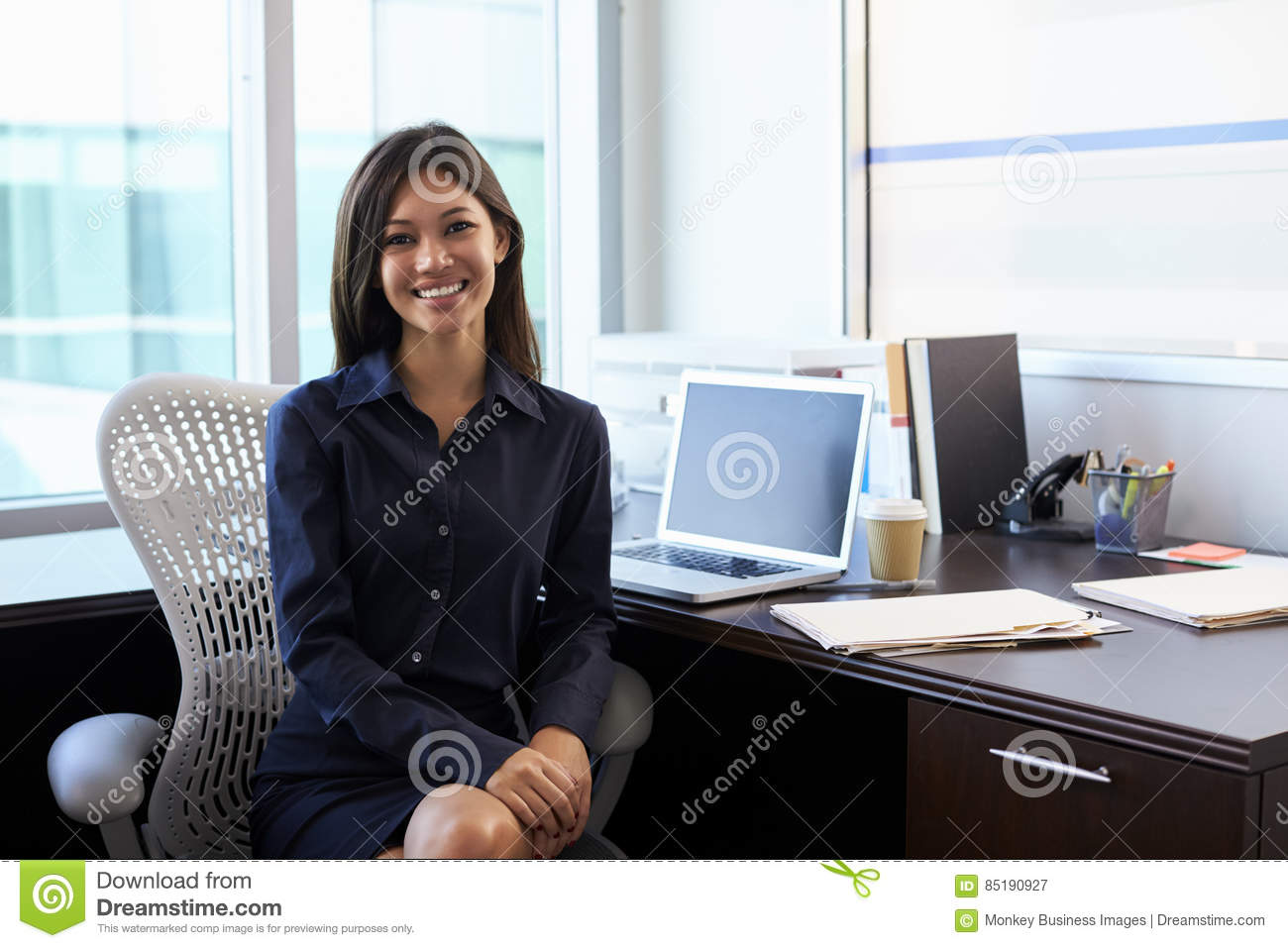 Portrait of female doctor sitting at desk in office stock image image 85190927 - Office portrait photography ...