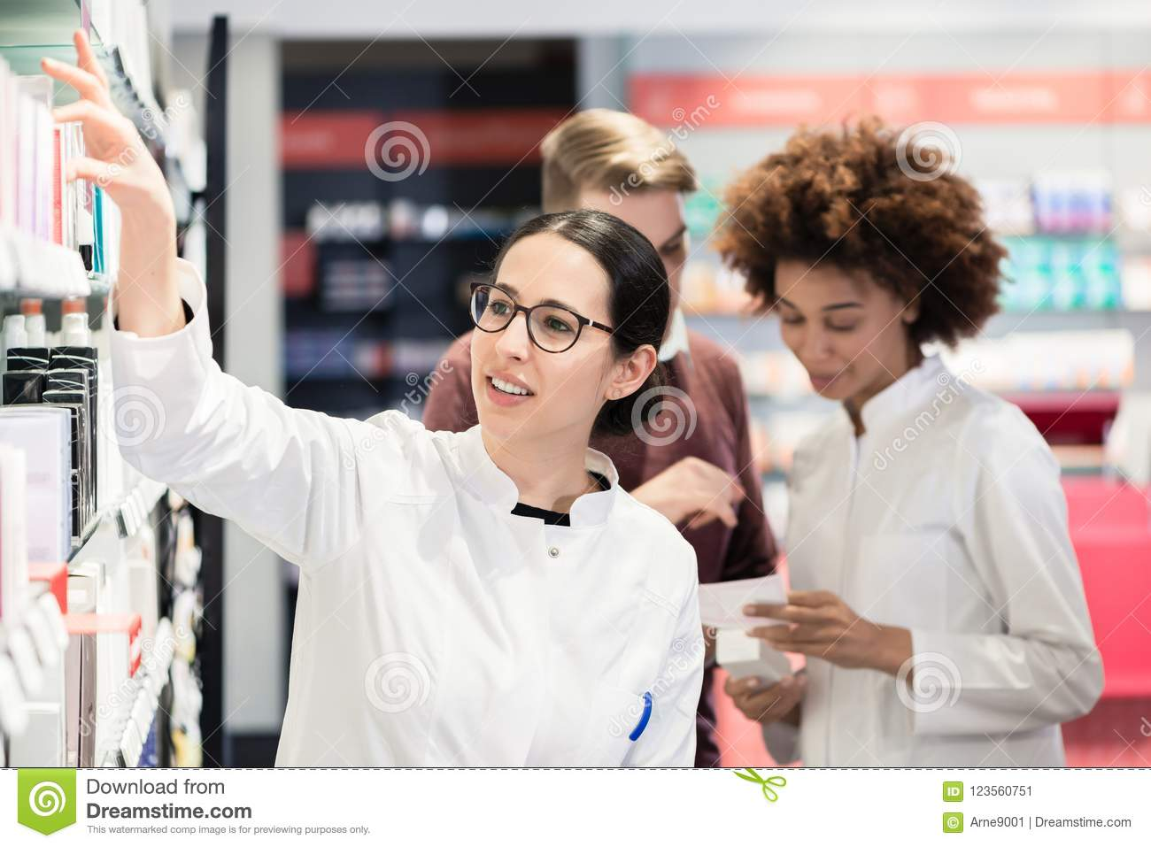 Portrait of a female experienced pharmacist reading indications