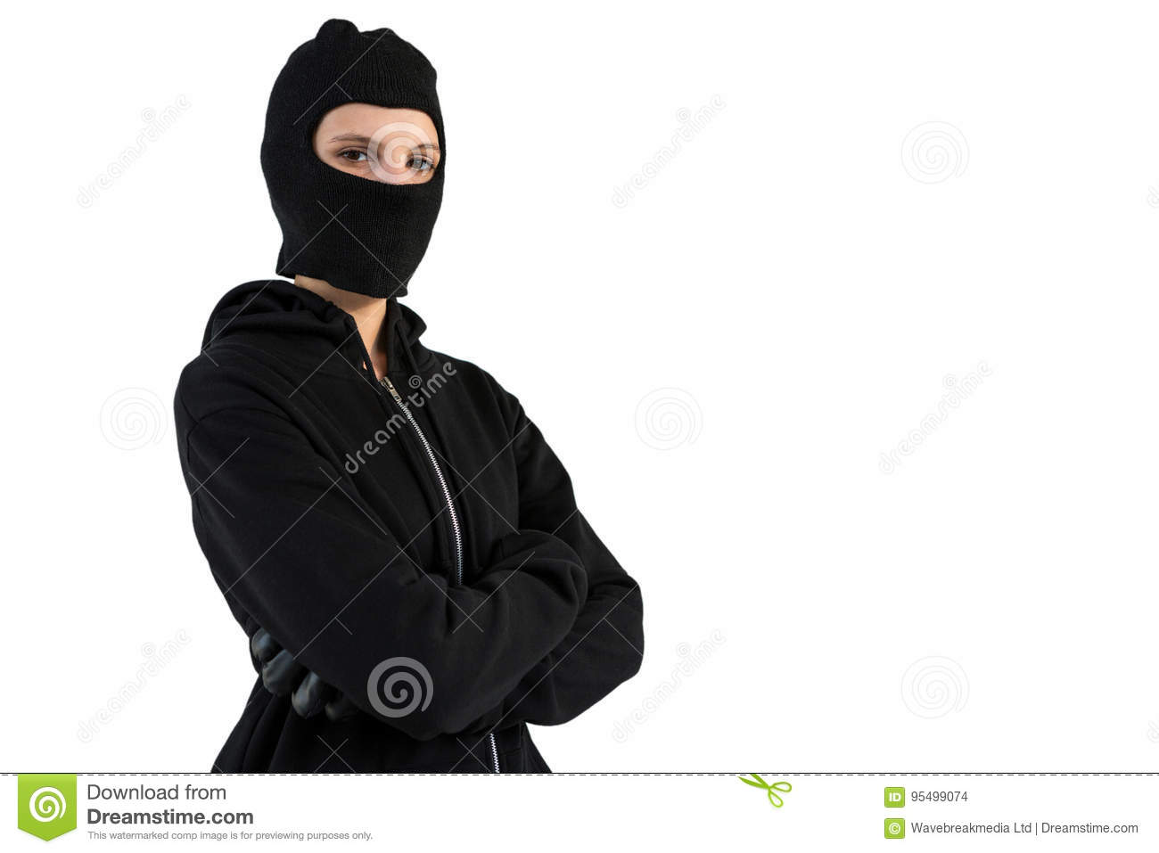 Portrait of female hacker standing with arms crossed