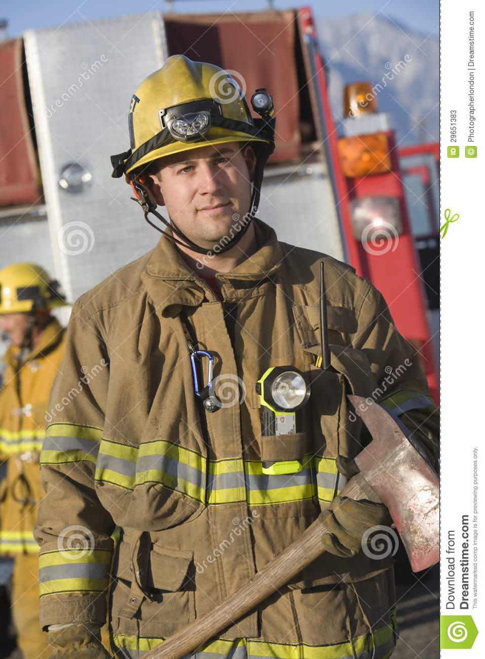 Portrait Of A Firefighter Holding Axe Stock Photos - Image ...