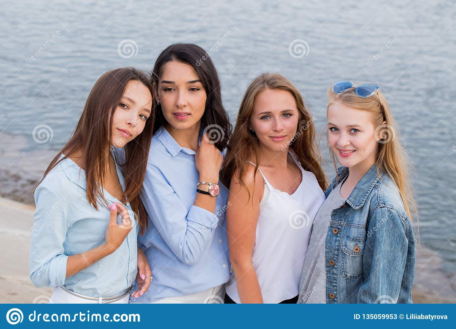 Portrait of four femle friends looking friendly at camera, smile, happy. people, lifestyle, friendship concept