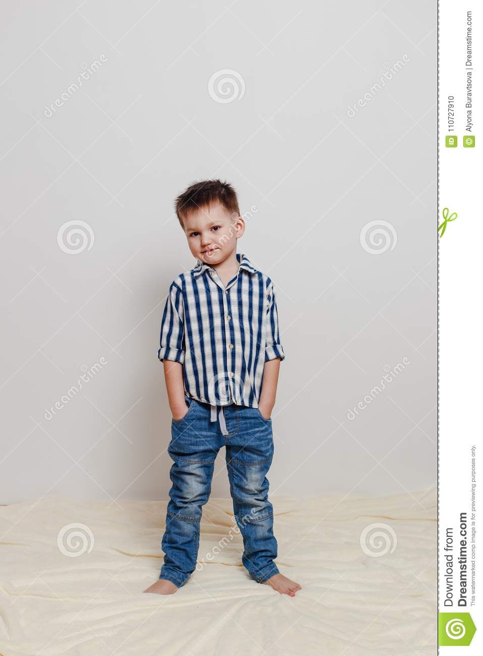 4 Year Boy Bedroom Decorating Ideas: Portrait Of A Four-year-old Boy In A Shirt And Blue Jeans