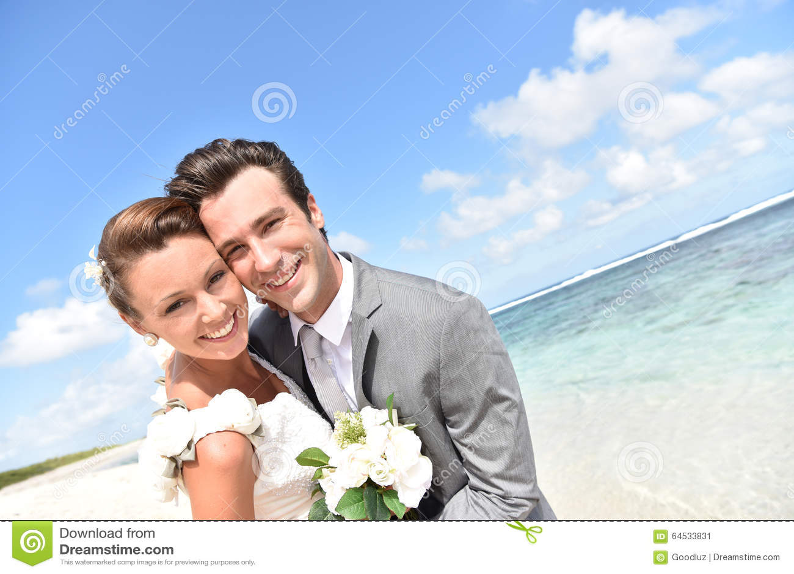 Portrait of freshly married couple on caribbean beach