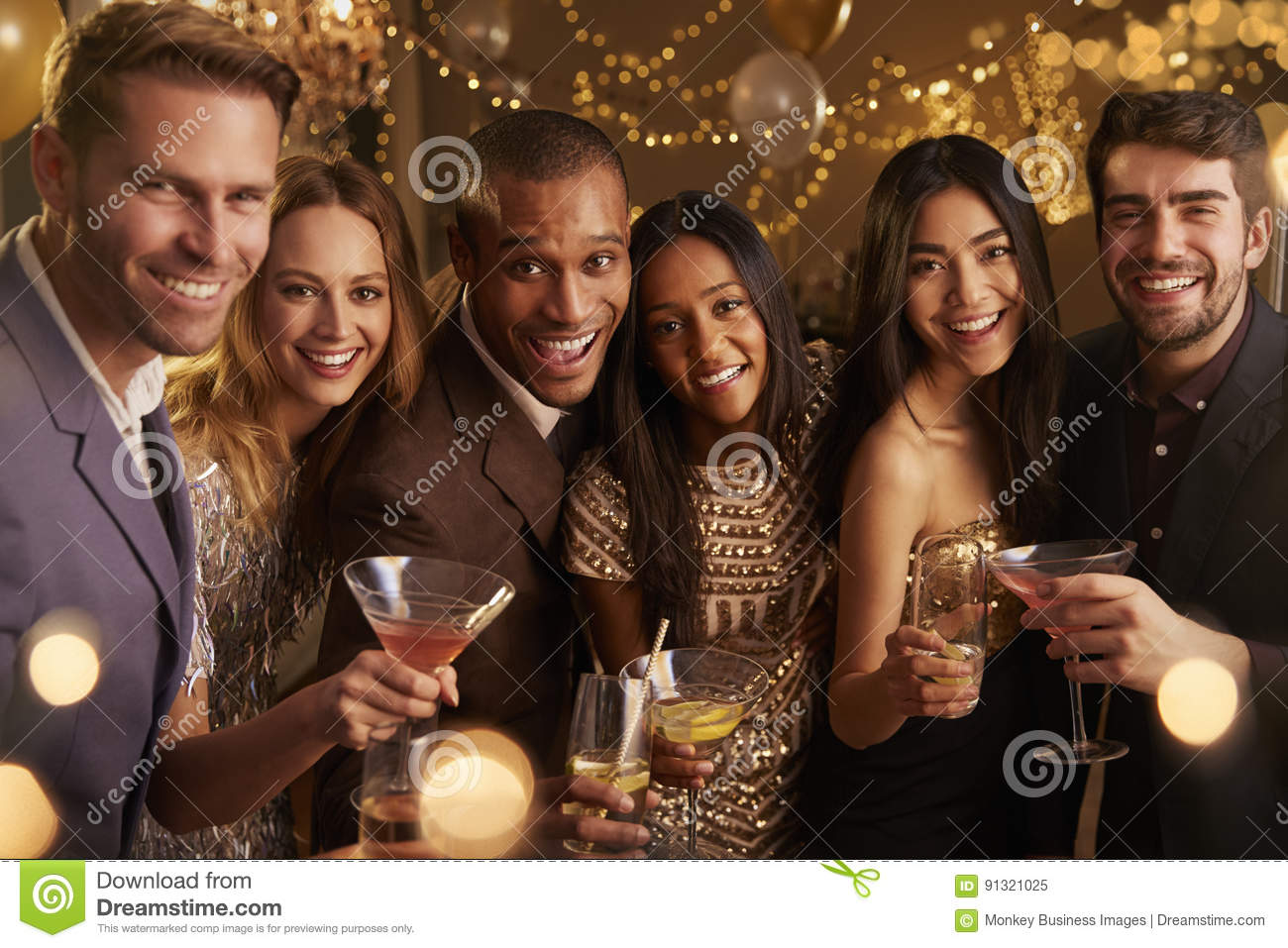 Portrait Of Friends With Drinks Enjoying Cocktail Party