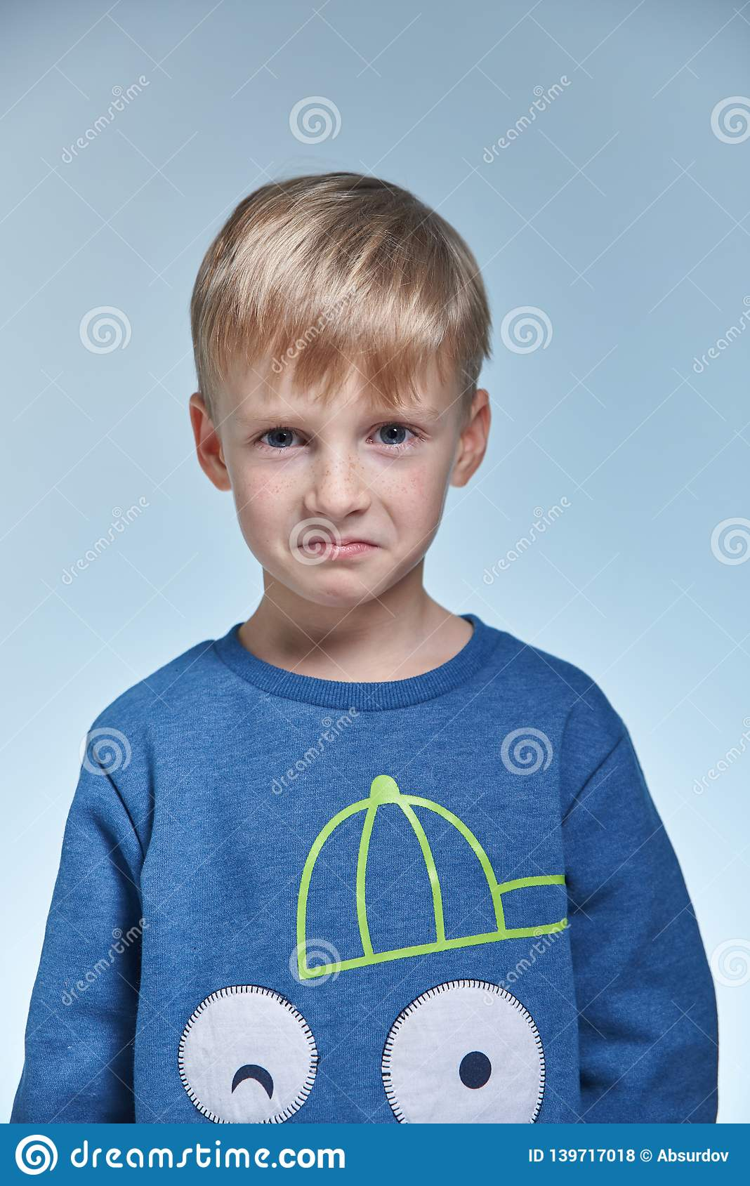 Portrait Of A Funny Emotional And Cunning Boy Stock Photo ...