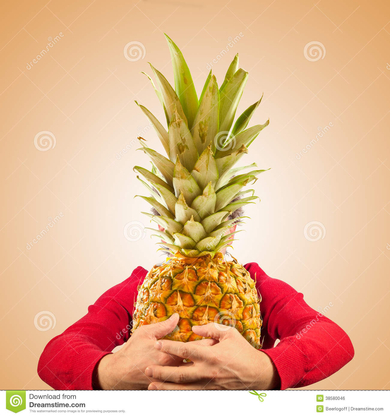 Portrait of funny man with pineapple