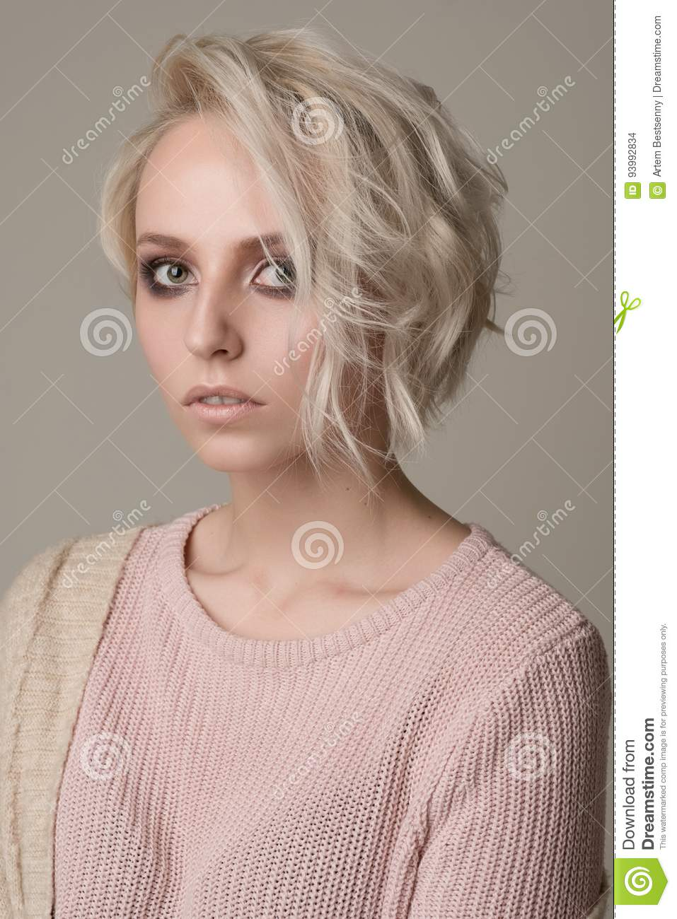 Portrait Of Girl Of Blonde With Dark Eye Makeup And Short Hair