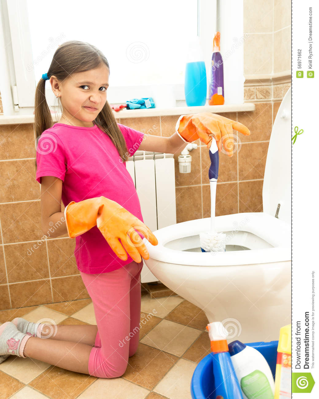 Portrait Of Girl Cleaning Toilet With Disgust Stock Photo