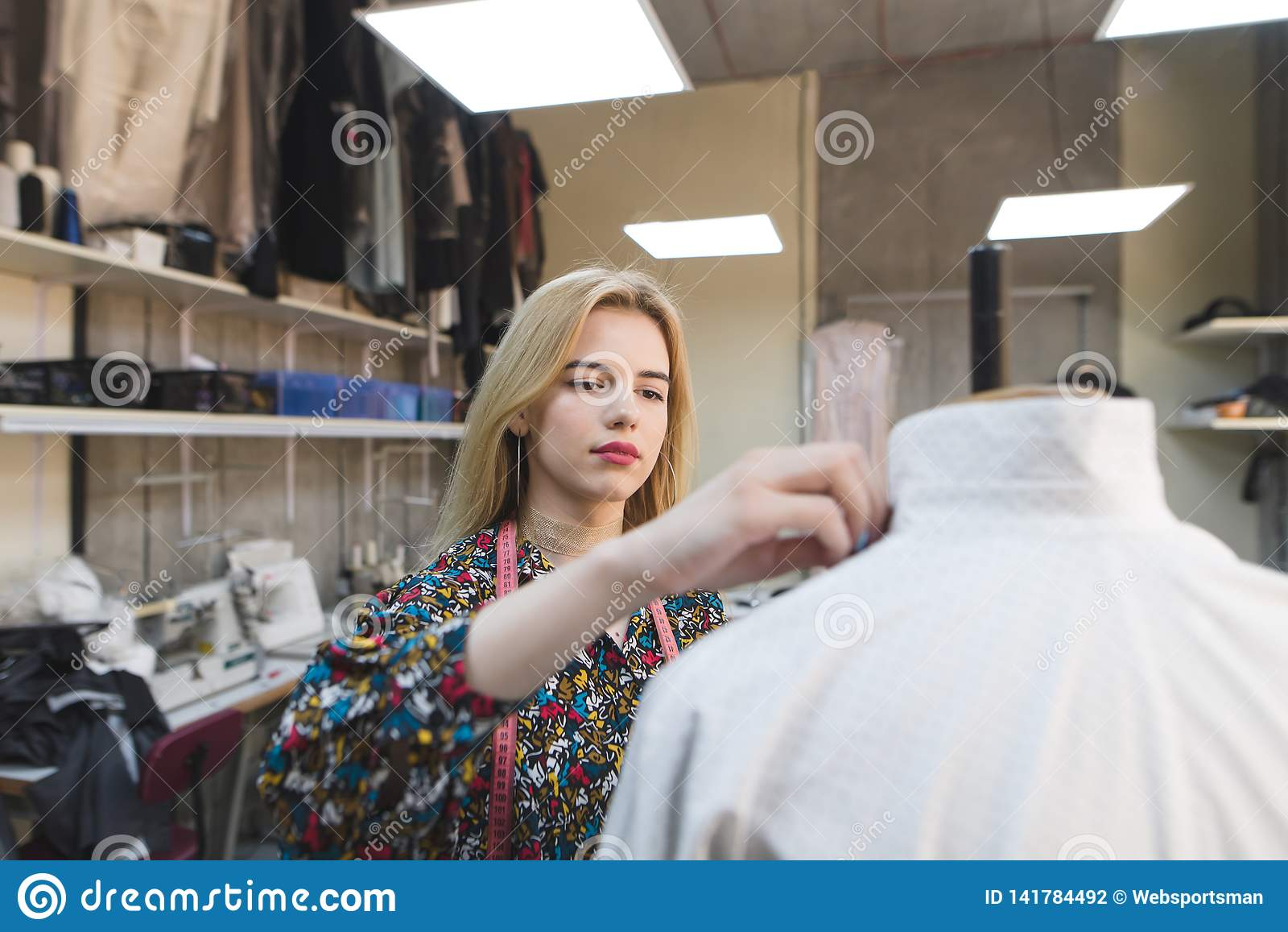 Portrait Of A Girl Couturier Who Creates Clothes In Her Own Design Studio Fashion Designer At Work Stock Photo Image Of Designer Occupation 141784492