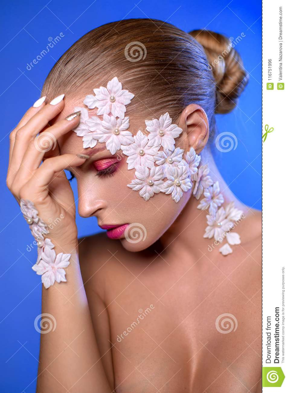 Portrait of a girl with flowers on her face