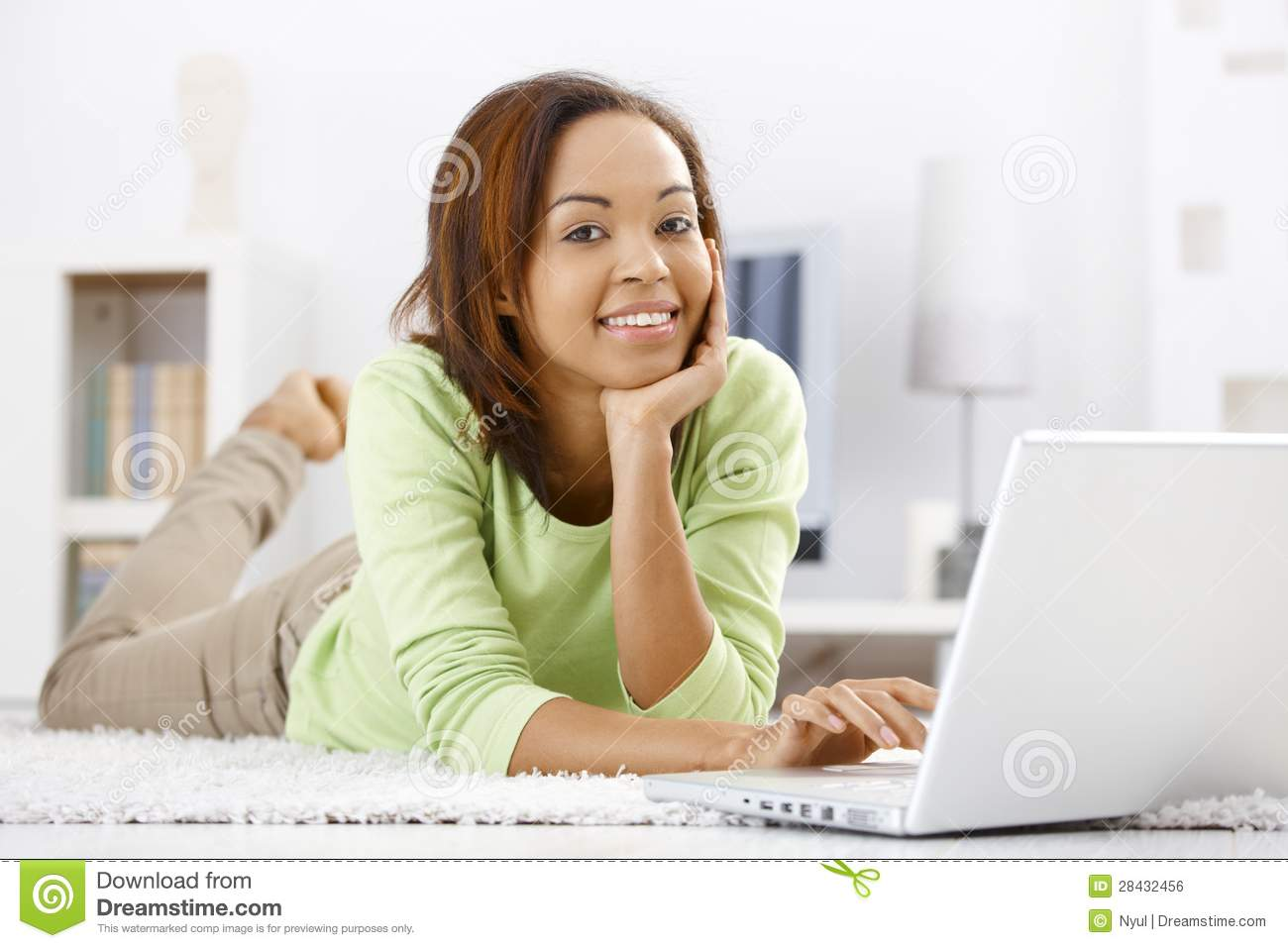Portrait of girl at home with laptop