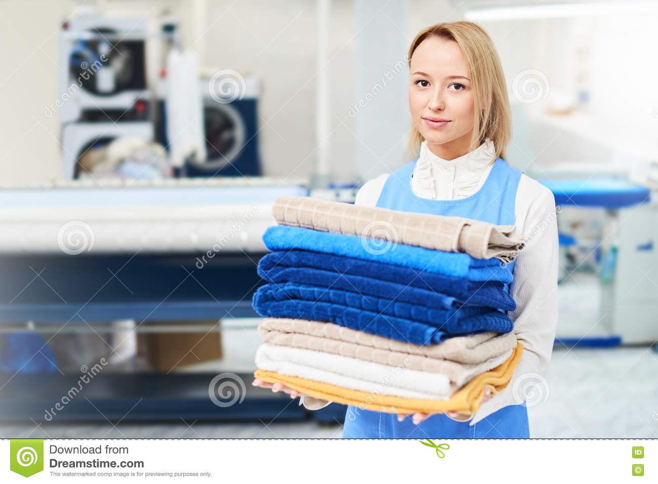 Portrait of a girl Laundry worker holding a clean towel