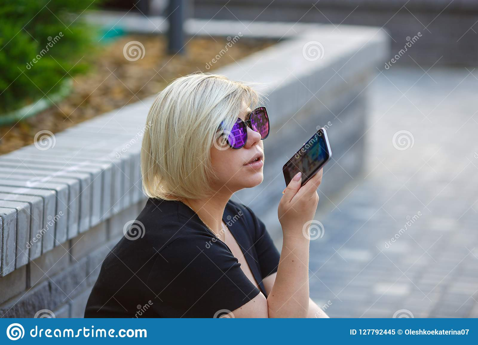 Portrait girl student outdoors talking on phone