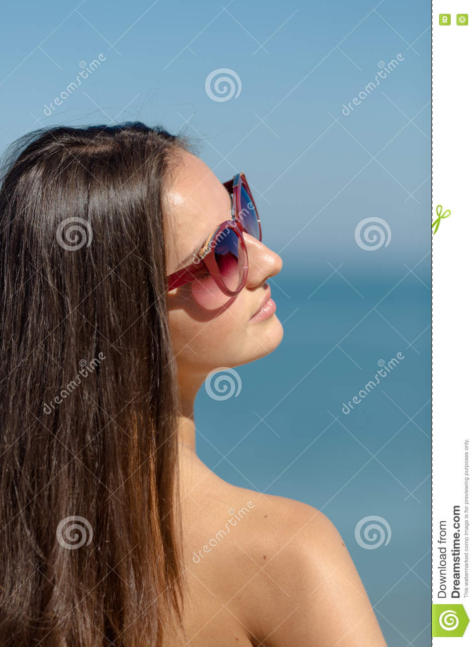 Portrait of girl in sunglasses on background of sea