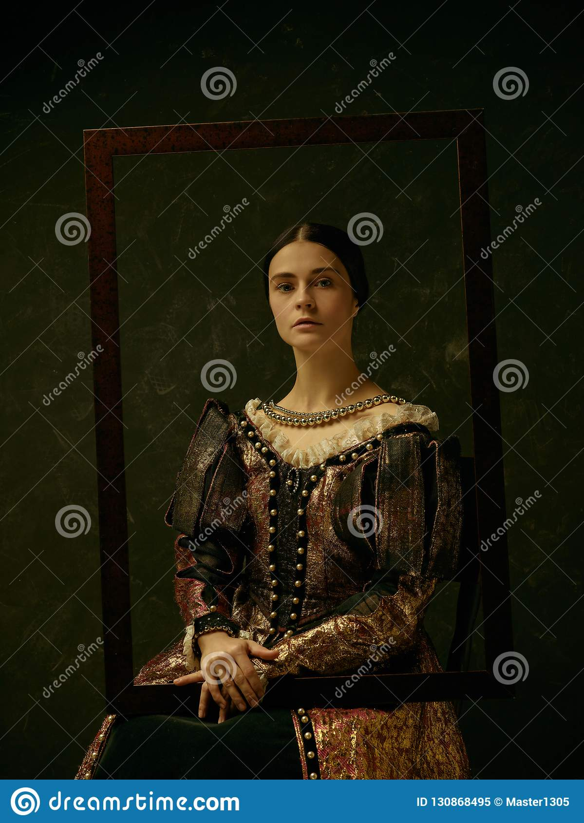 Portrait of a girl wearing a retro princess or countess dress