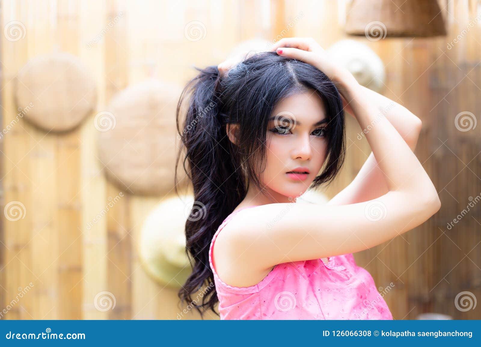 Portrait gorgeous asian woman. Charming beautiful young woman ha