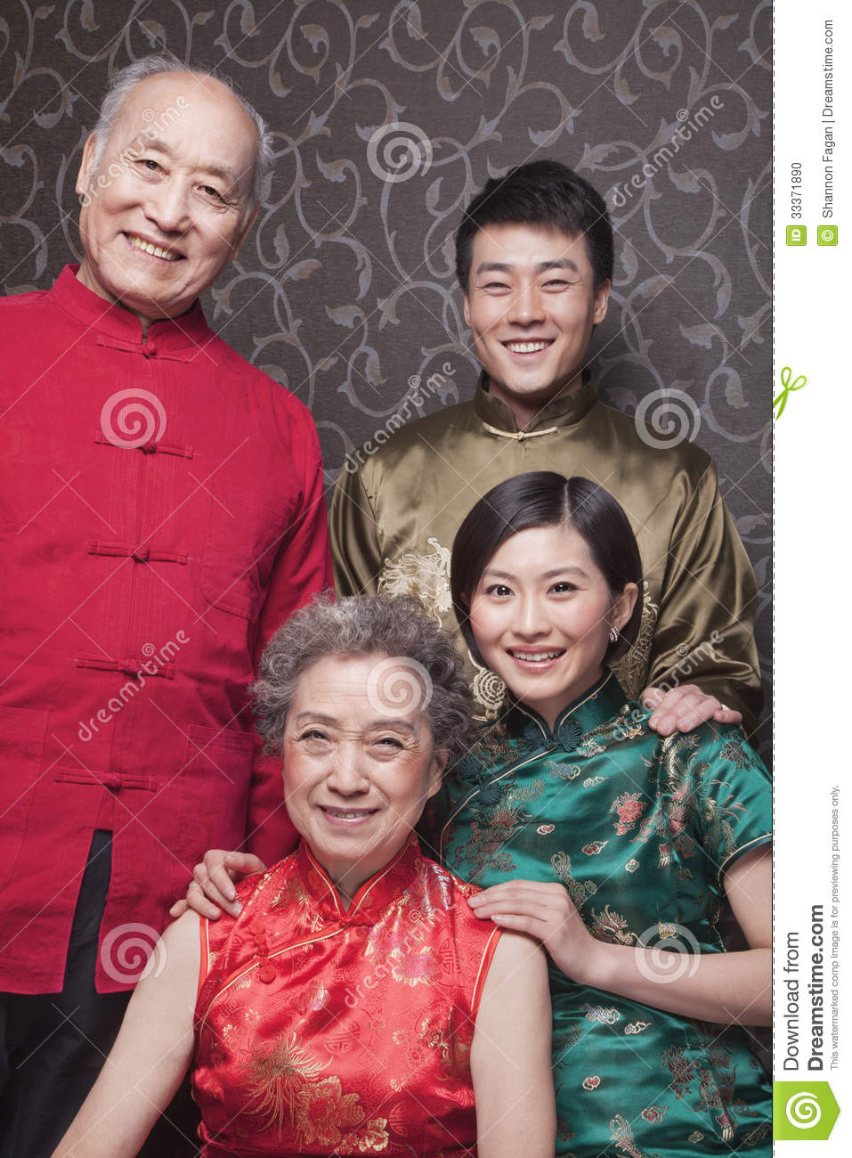 Portrait Of Grandparents And Adult Grandchildren In