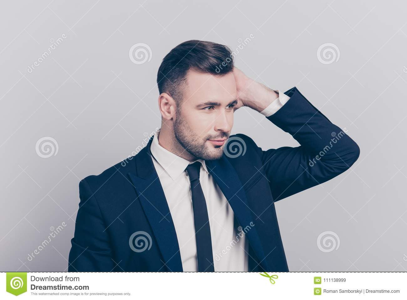 Portrait of half turned stunning ideal boss touching his hair lo