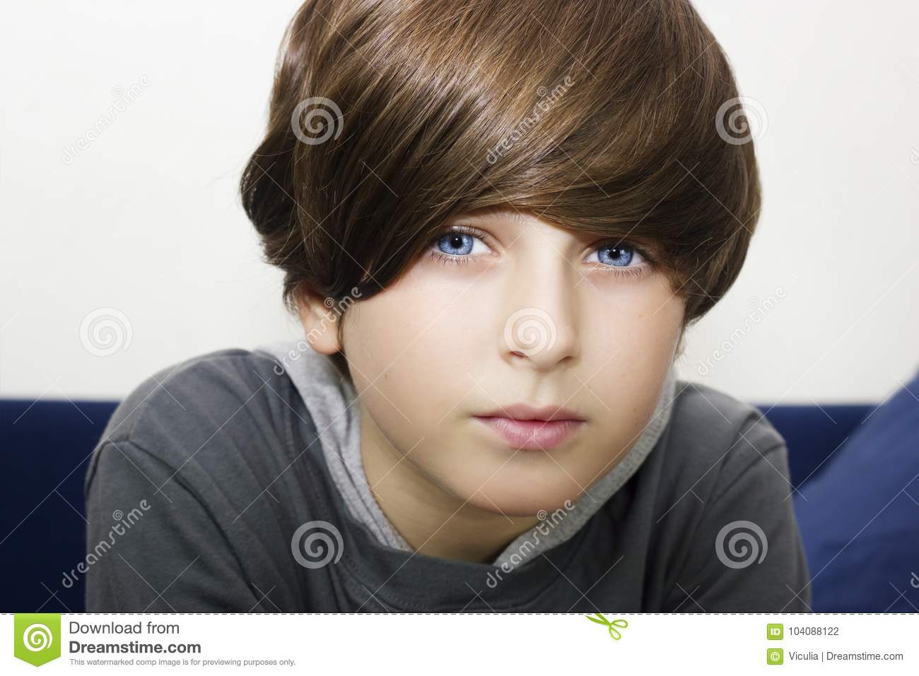A Portrait Of A Handsome Blue Eyes Boy Kid Possing Stock Photo