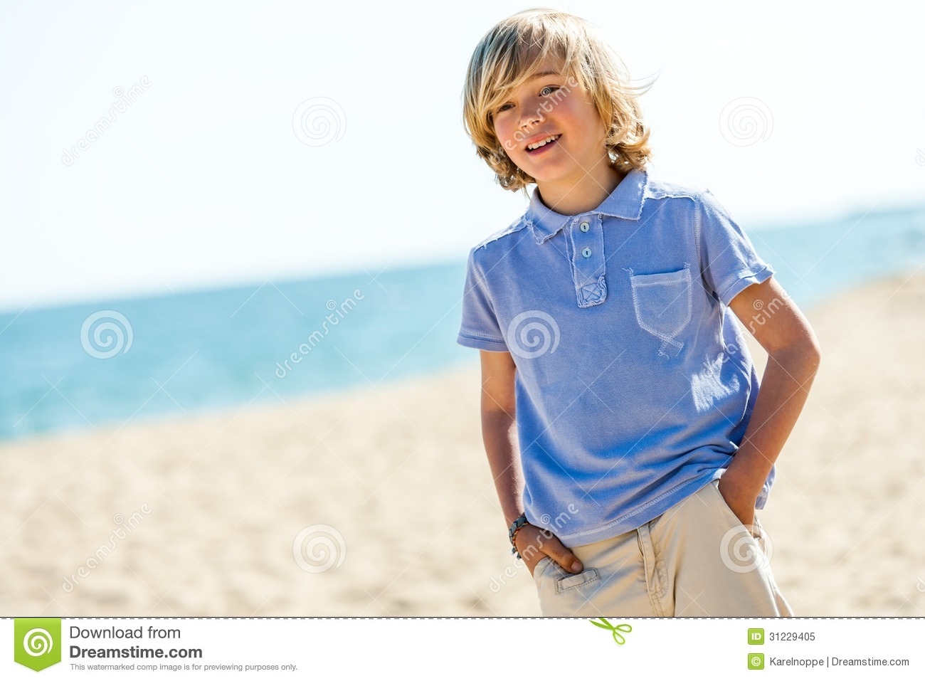 Portrait Of Handsome Boy Standing On Beach Royalty Free
